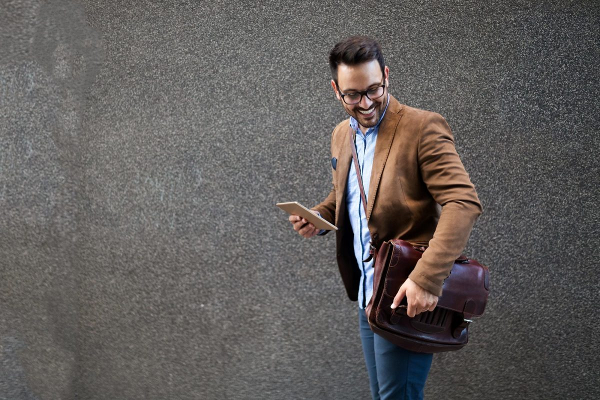 handsome-male-marketing-experts-walking-on-city-st-EFQP5RY-1.jpg